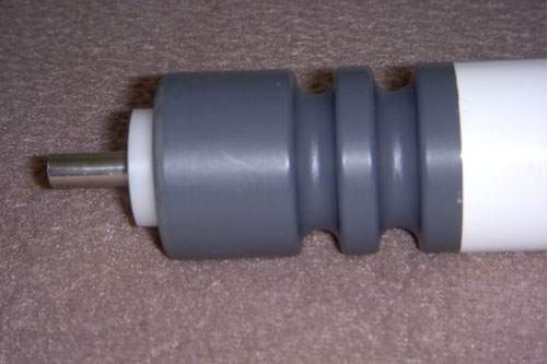 Light duty roller with 1/4 inch round shaft for line shaft driven applications